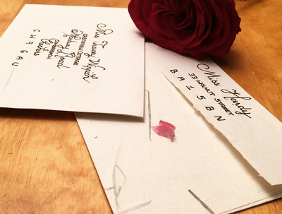 In calligraphy hand-write your envelopes (invitation, greetings card) x 12