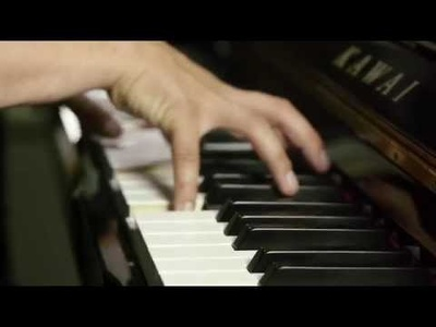 Compose an original piano track, recorded professionally on an acoustic piano.