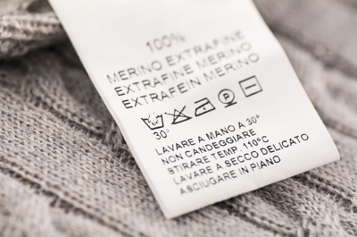 Design a bespoke garment care instruction label for clothing