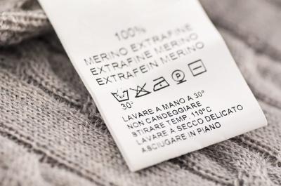Design a bespoke garment care instruction label for clothing
