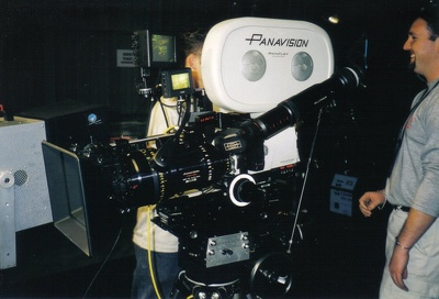 Operate a film camera  using  geared camera heads.