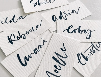 Offer calligraphy service for 100 place cards/ envelopes addressing