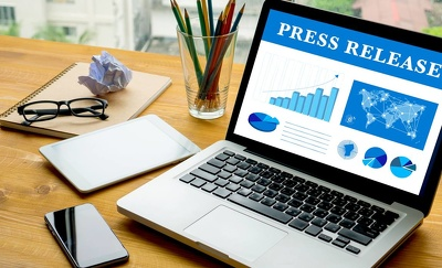 Write a professional press release and distribute it to 20 sites