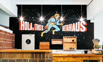 Create and paint a mural based on lettering.