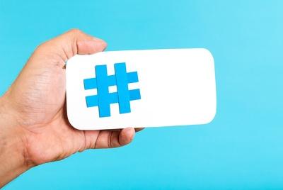 Provide 12 custom Twitter hashtags